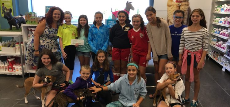 Local Girl Scout Troop Raises $400 for Ruff House!